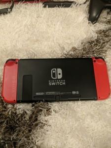 Nintendo Switch rouge +  jeux + acessoires